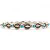 Heavy Stamped Zuni Snake Eye Turquoise Bangle