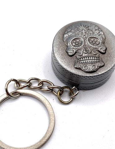 Two part silver metal key ring grinder