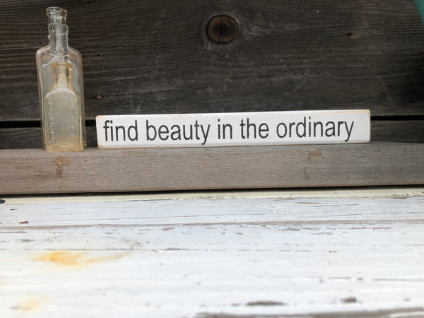 Find beauty in the ordinary wood sign