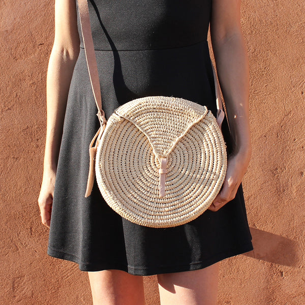 Small round natural straw bag