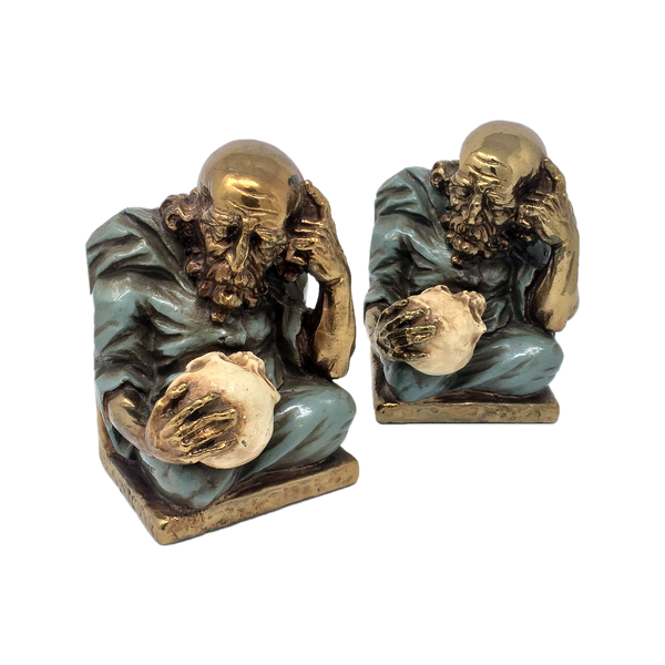 Antique bronze-clad alchemist with skull bookends by Marion Bronze circa 1922