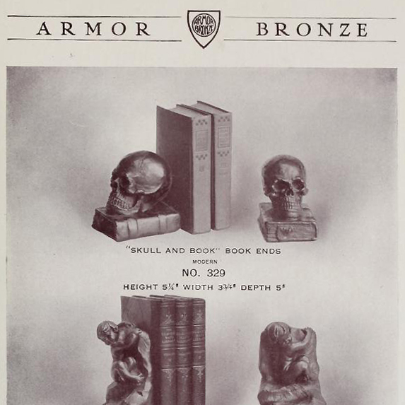 Antique bronze-clad skull and grimoire bookends by Armor Bronze circa 1922