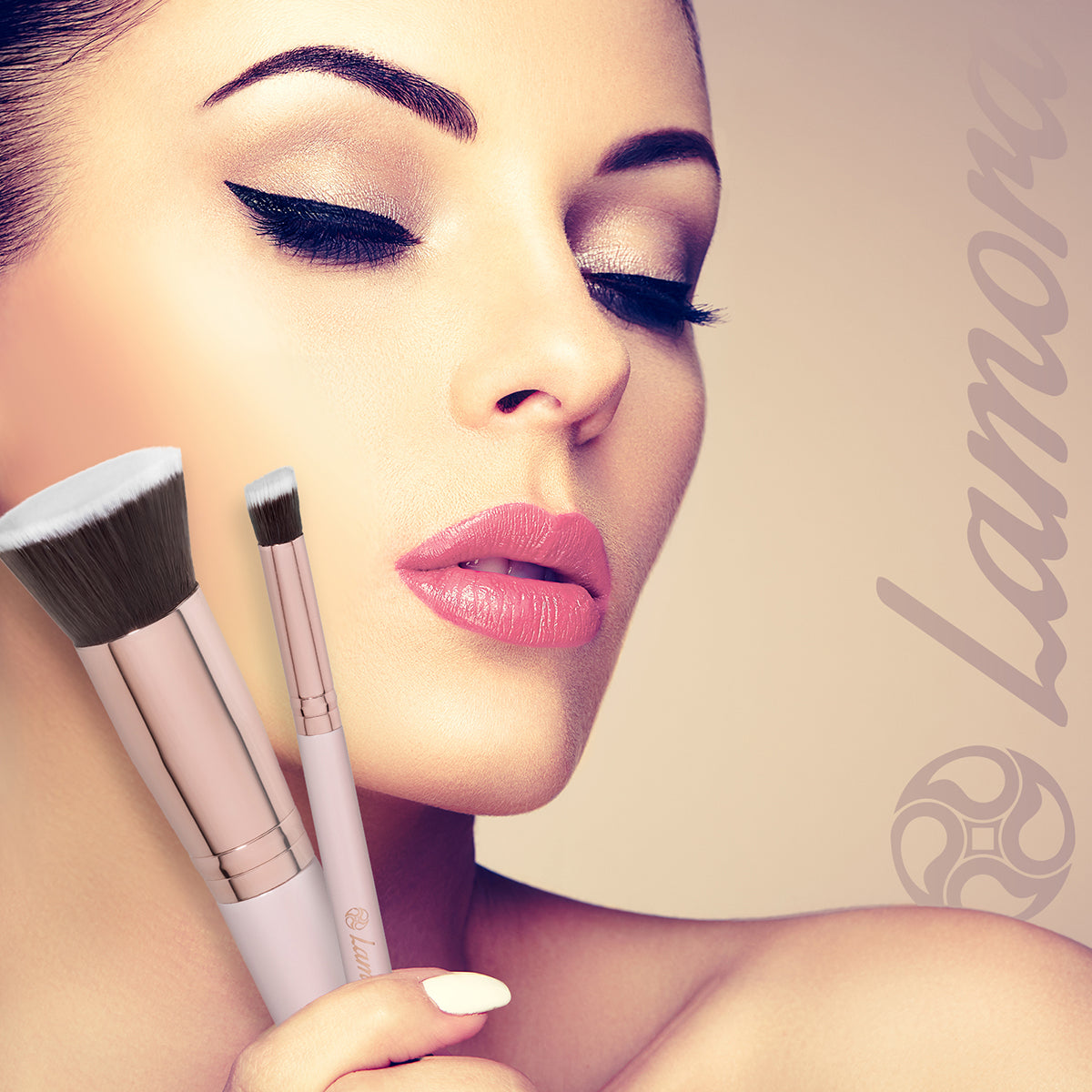 Beautiful woman holding brushes used to apply foundation