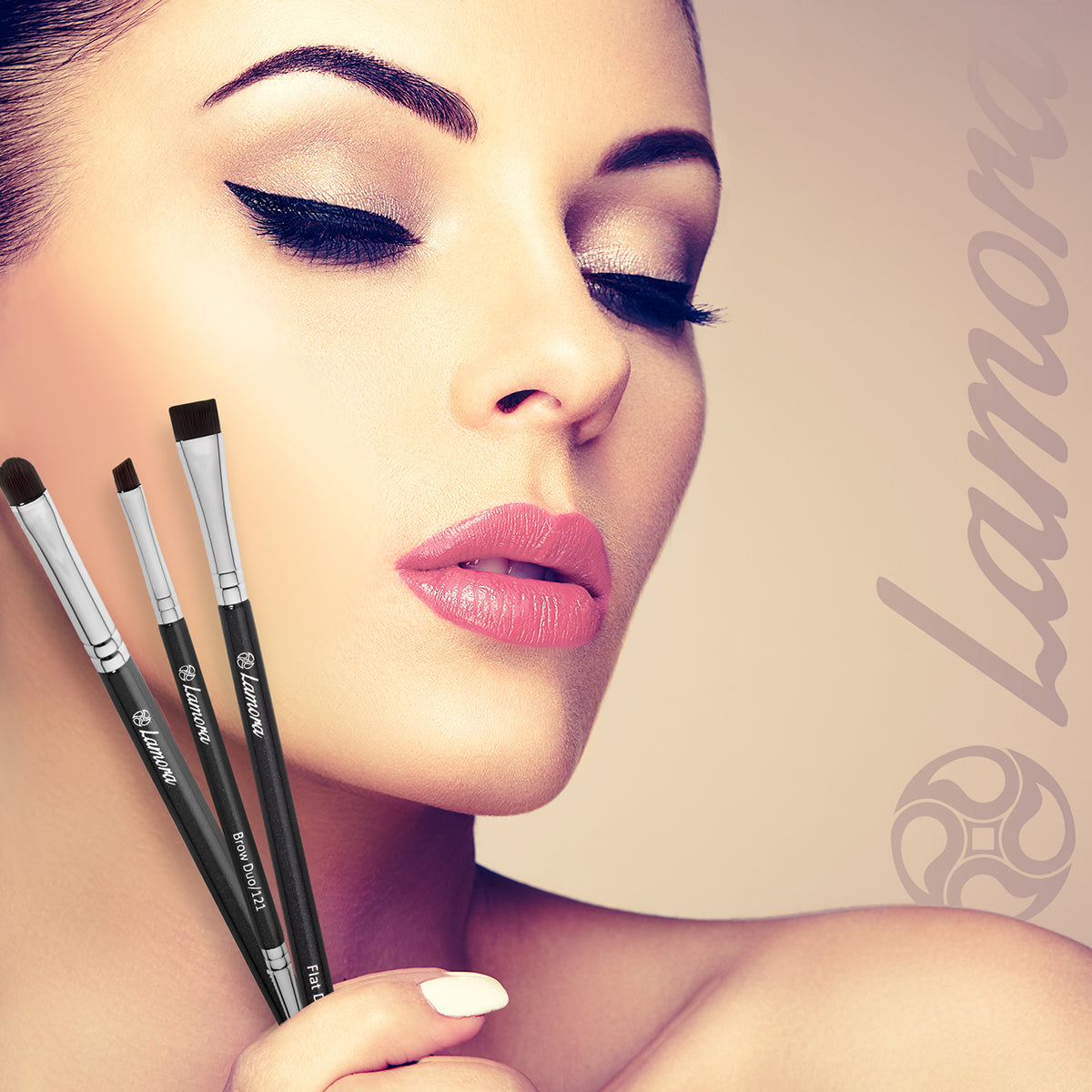 Beautiful woman holding brushes used to shape and color the eyebrow