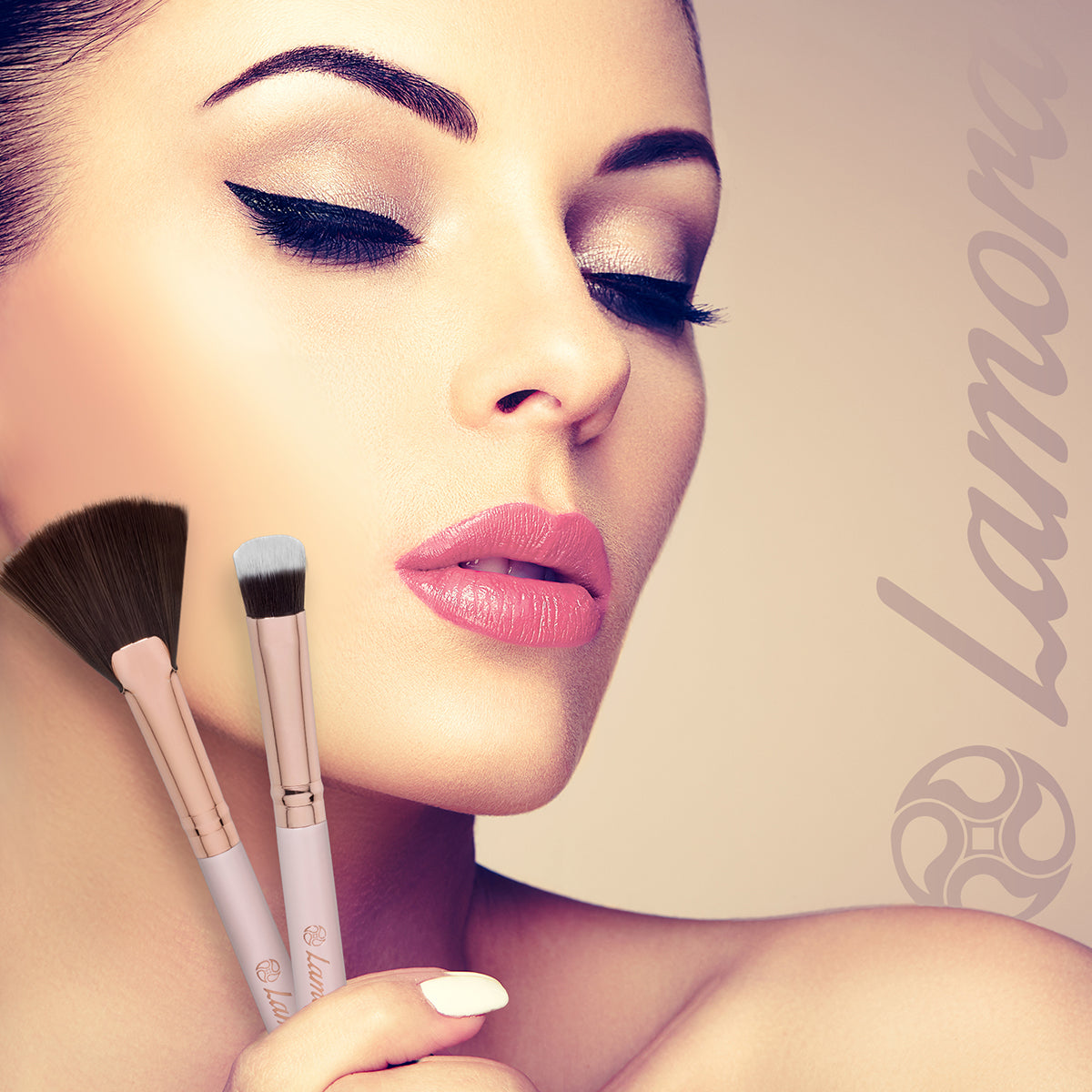 Beautiful woman holding brushes used to contour the face