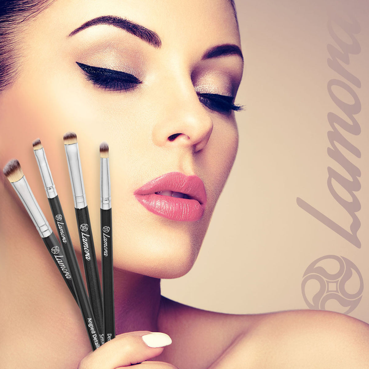 Beautiful woman holding brushes used to apply eyeshadow