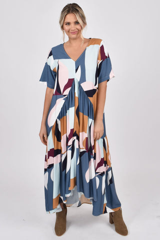 model wears blue geometric leaf print gathered peak maxi dress