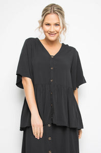 black shirt with t-shirt sleeves, peplum style frill, statement buttons and generous fit