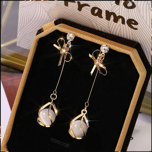 Long Bow and Pearl Earrings