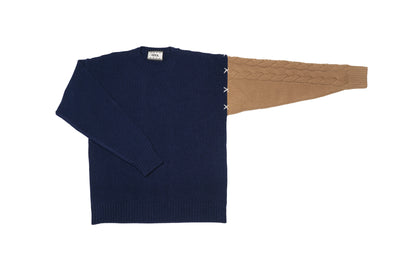 Cashmere sweater with a cable sleeve