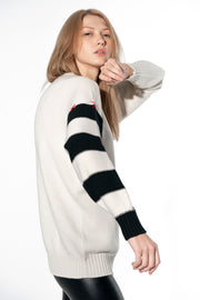Cashmere sweater with a striped sleeve