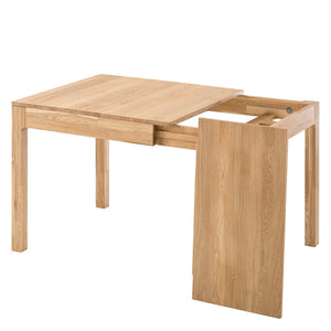 Extending solid wood oak dining table