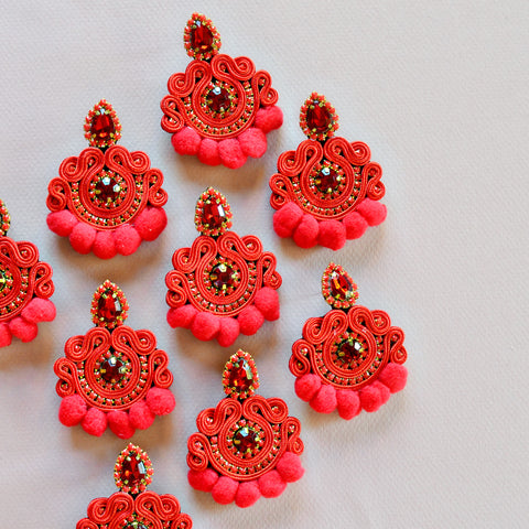 Handmade red beaded pom earrings