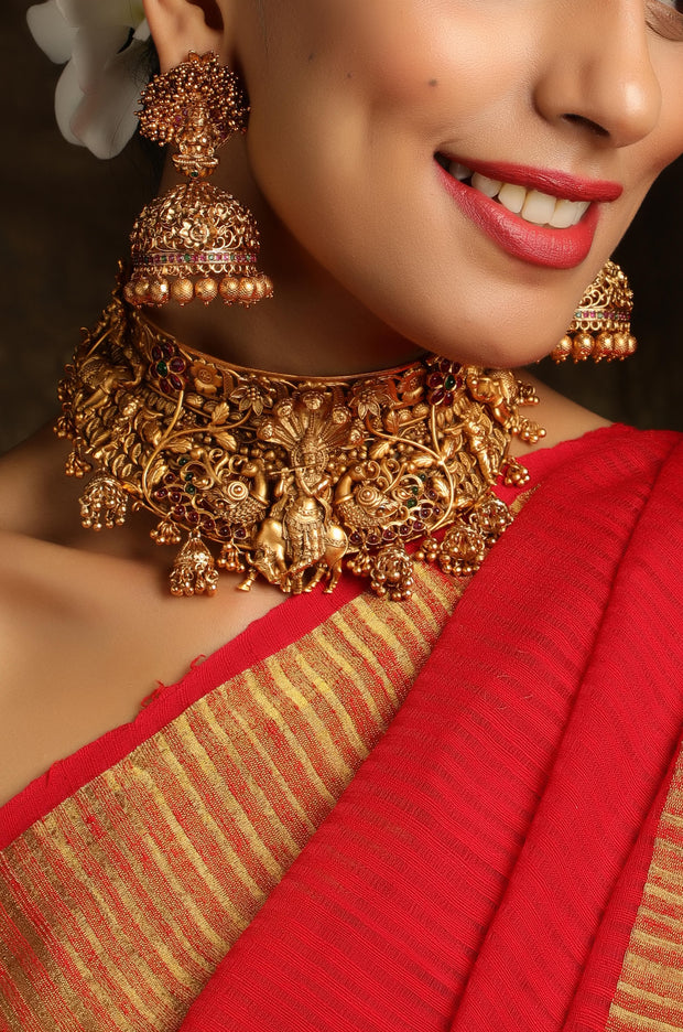 Anisha Gold Tone Temple Work Necklace with Jhumkis
