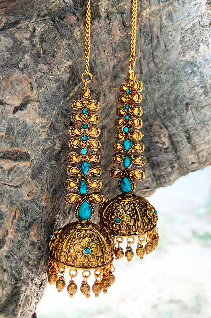 Tejaswini Turquoise Gold Tone Temple Work Jhumkis with Hair Chain