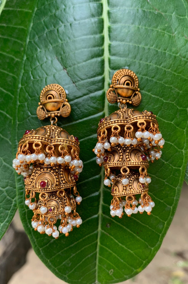 Hiranya Gold Tone Temple Work Jhumkis With Shell Pearls