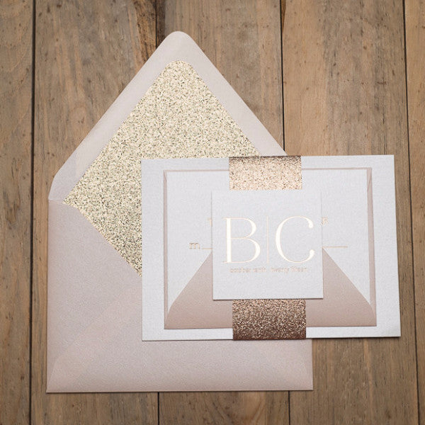 gold-glitter lined envelopes