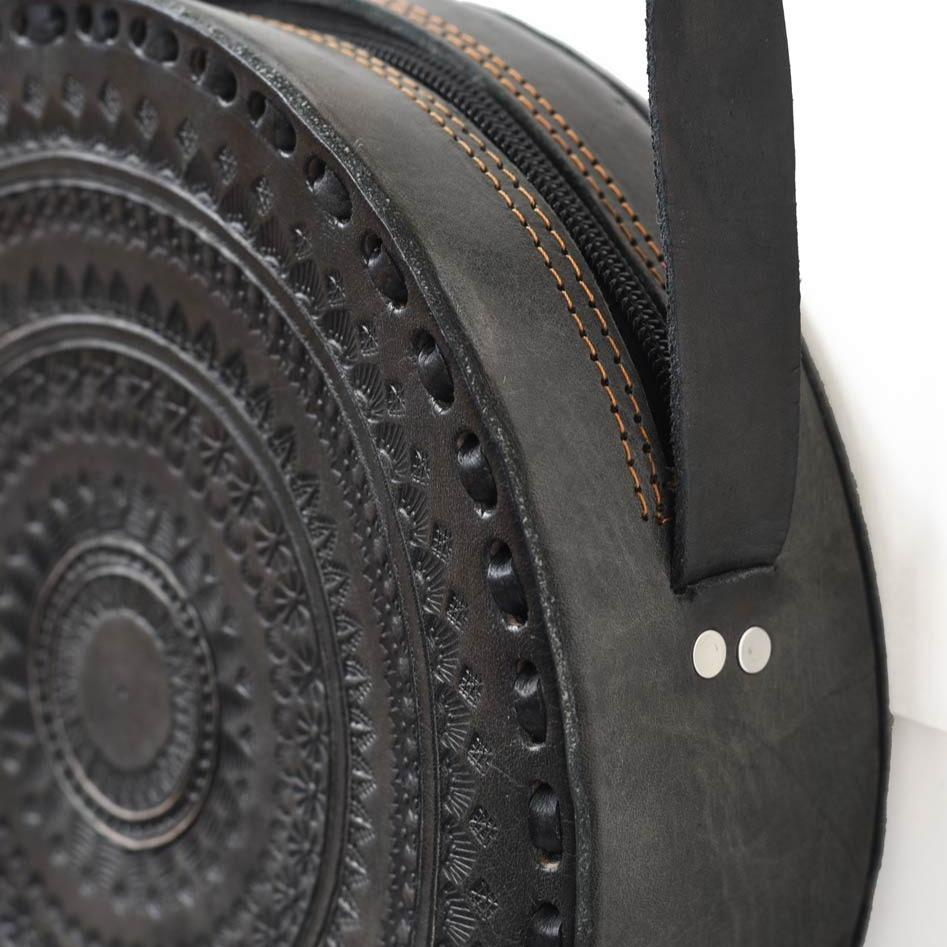 Embossed Circle Crossbody