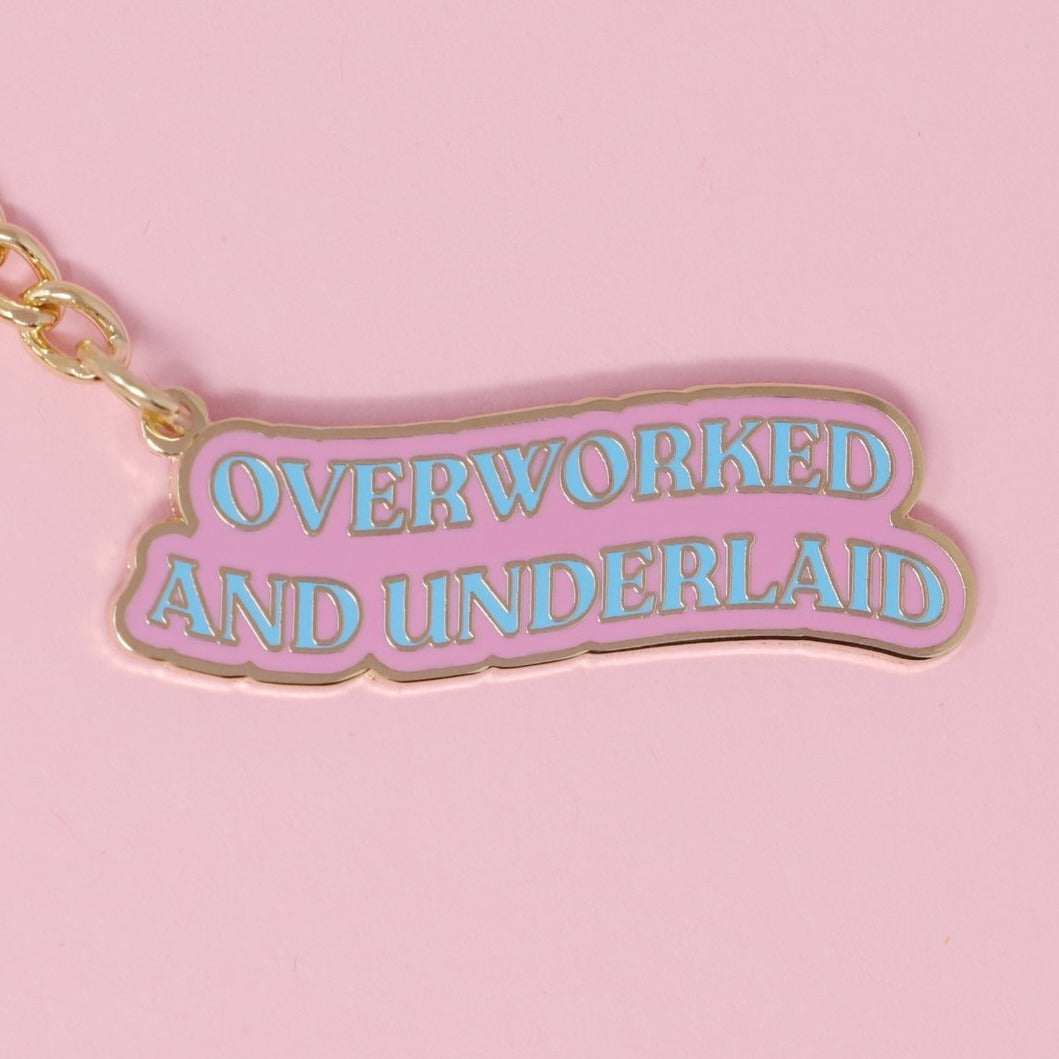 Overworked And Underlaid Keychain