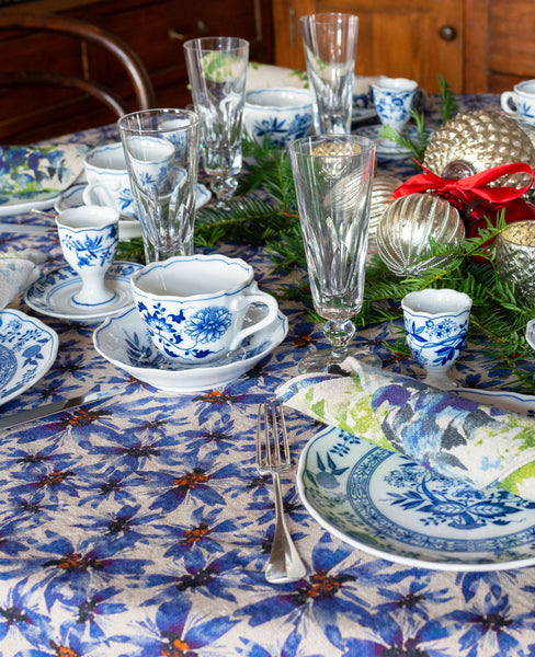 Blue and white table scape with blue floral linen table cloth and napkins