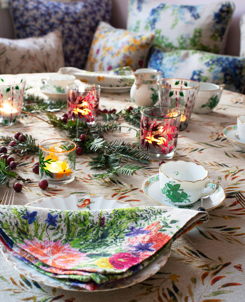 Colorful and floral table scape with organic linen tablecloth and napkins.