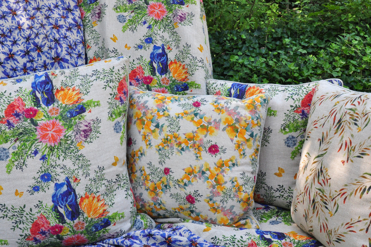 Floral pattern cushions in an outdoor setting.