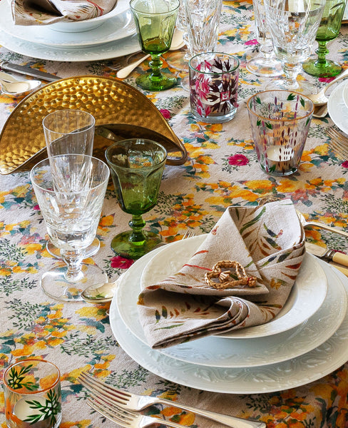 Yellow and gold table scape with organic linen tablecloth and napkins