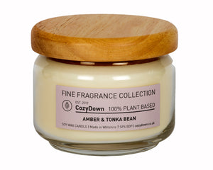 "CozyDown Fine Fragrance Amber & Tonka Bean 35cl Pop Jar in recycled glass with a wooden ""pop"" lid.  Made with only the highest quality natural aromas in 100% pure plant wax. Contains soy wax. This product is VEGAN"