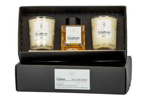CozyDown Signature Gift Set 2 glass votives and a mini natural rattan reed room diffuser. Contains essential oils of orange, neroli, ylang ylang and patchouli. 100% plant based. soy wax. VEGAN. alcohol and glycol free. plant based oil