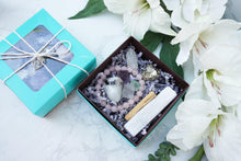 Load image into Gallery: Contempo Crystals - Teal lid and open Crystal Gift Set with Rose Quartz Bracelet, Selenite, Fluorite Octahedrons, Moonstone Tumble, Pyritte Chunk, Quartz Point and a Palo Santo Stick - Image 3