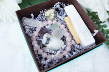 Load image into Gallery: Contempo Crystals - Close up of Crystal Gift Set with Rose Quartz Bracelet, Selenite, Fluorite Octahedrons, Moonstone Tumble, Pyritte Chunk, Quartz Point and a Palo Santo Stick - Image 2