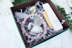 Contempo Crystals - Close up of Crystal Gift Set with Rose Quartz Bracelet, Selenite, Fluorite Octahedrons, Moonstone Tumble, Pyritte Chunk, Quartz Point and a Palo Santo Stick - Image 2