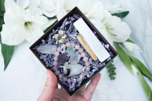 Contempo Crystals - Close up of Crystal Gift Set with Rose Quartz Bracelet, Selenite, Fluorite Octahedrons, Moonstone Tumble, Pyritte Chunk, Quartz Point and a Palo Santo Stick - Image 4