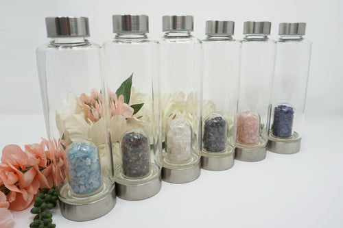 Gemstone Glass Water Bottle. With crystal glass inserts! Rose quartz, aquamarine, lapis lazuli, multi-color tourmaline, clear quartz and amethyst variants.