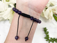 Load image into Gallery: Contempo Crystals - Amethyst and double terminated quartz point Mala bracelets with pull string closure. - Image 5