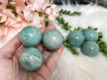 Load image into Gallery: Contempo Crystals - Amazonite Spheres with a gorgeous color of teal blue! Shimmer from the chatoyancy. Helps reduce stress after traumas, and helps to soothe. - Image 2