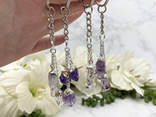 Load image into Gallery: Contempo Crystals - Silver plated clear quartz and amethyst crystal point keychains. - Image 6
