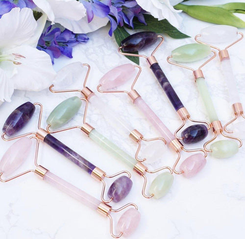 Crystal Face Rollers in Jade, Rose Quartz, Chevron Amethyst, Quartz, Obsidian and Tiger Eye. With rose gold colored metal accenting.
