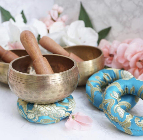 Singing Bowl Set with one bowl, a hand-sewn donut cushion and a mallet original from Nepal! Align your body's frequencies back to normal state.