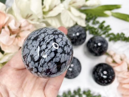 Black and white snowflake obsidian sphere.