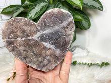 Load image into Gallery: Contempo Crystals - Unique Amethyst Flower crystal hearts. Great raw crystal cluster cut into the heart shape. Protection, purification, and can also help promote a restful night of sleep. - Image 4