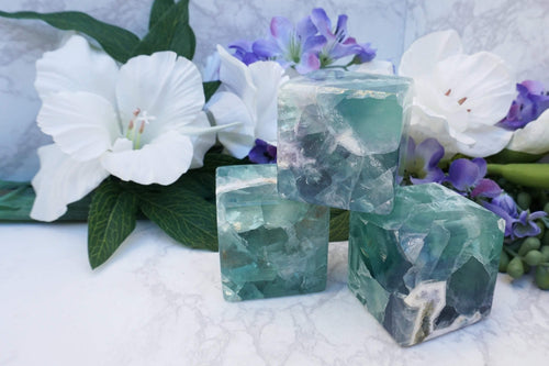 Fluorite Cube. Mexical fluorite crystal with incredible coloring and appearance. A harmonizing stone for better decision making and connecting with your higher-self.