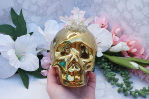 Contempo Crystals - Quartz Skull Piggy Bank. Front view in hand - Image 6