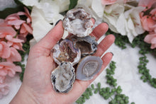 Load image into Gallery: Contempo Crystals - Occo Quartz Geode Magnet. In hand - Image 2