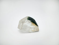Meralt, milky quartz with distinct chlorite inclusions and curved surface