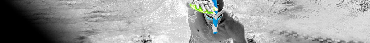 underwater view of man swimming using swim hand paddles from the MP swim training gear collection