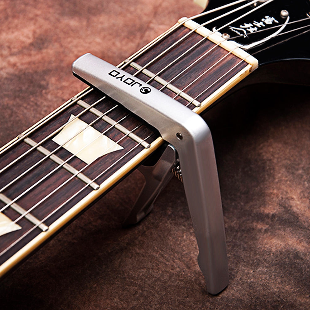 JOYO JCP - 01 Light Capo Classic Capodastre with Plectrum Pick for 6 String Acoustic Electric Guitar