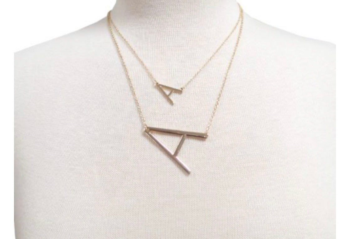 Layered sideways initial necklace