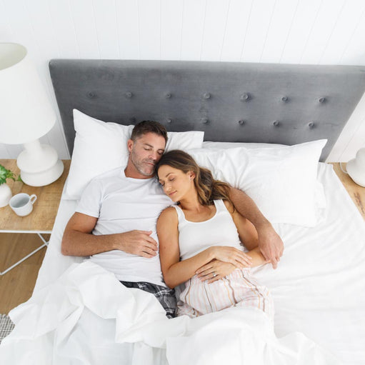 Couple sleeping on a bed with the Royal Deluxe Breathable Cotton Dream Sheets
