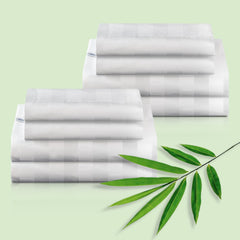 Two Royal Deluxe Natural Bamboo Dream Sheet Set folded with bamboo leaves